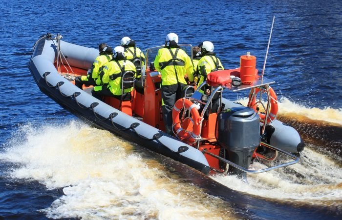 Strategic Security - rescue team on water raft